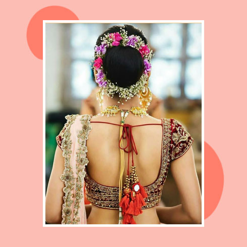 Reception Hairstyles for Saree – Bun with Baby's Breath